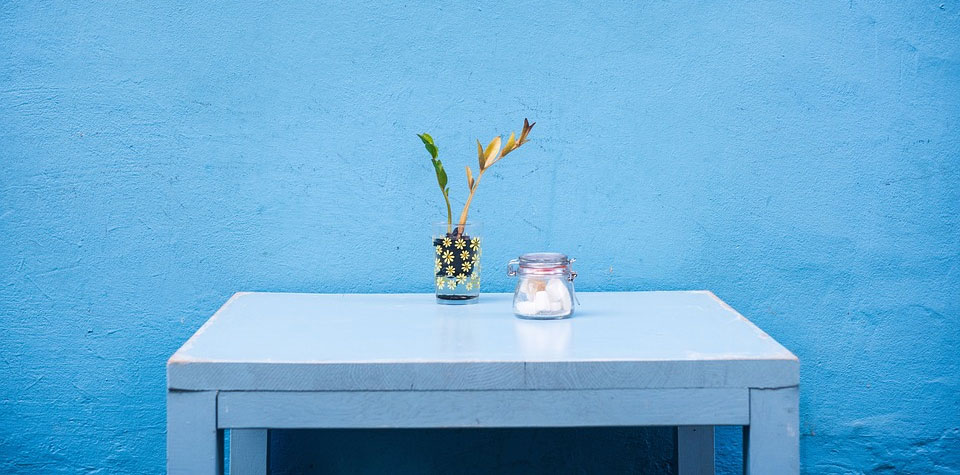 Blue wall with table